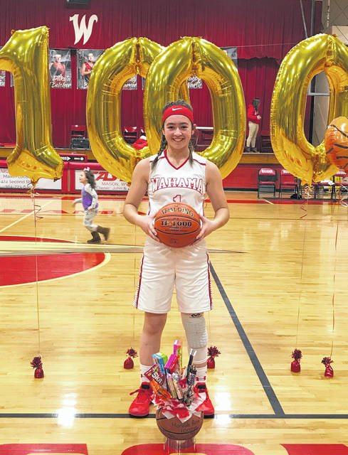 Wahama junior Hannah Rose poses for a picture after becoming the eighth Lady Falcon in school history to reach 1,000 career points on Thursday, Feb. 14, during a 44-34 victory over Miller at Gary Clark Court in Mason, W.Va.