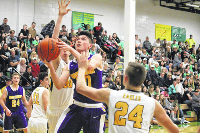 Southern senior Austin Baker goes for a layup, during the Tornadoes' 54-50 victory on Friday in Tuppers Plains, Ohio.