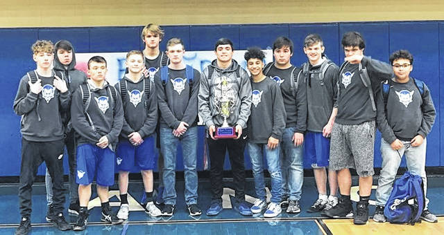 Members of the Gallia Academy wrestling team pose for a picture after winning the 2019 Ohio Valley Conference championship on Thursday at Gallia Academy High School in Centenary, Ohio.