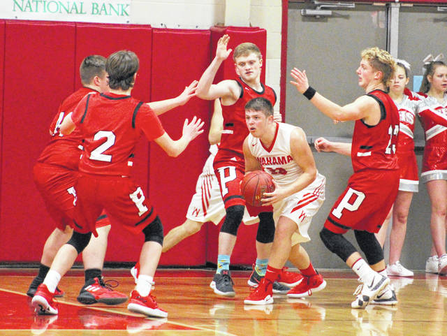 Wahama senior Brady Bumgarner is surrounded by a swarm of Point Pleasant defenders during the second half of Friday night's boys basketball contest at Gary Clark Court in Mason, W.Va.