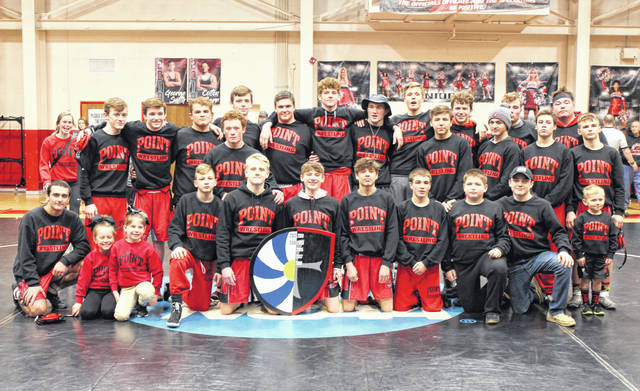Members of the Point Pleasant wrestling team pose with the shield after defeating Ripley 55-9 on Friday in Point Pleasant, W.Va.