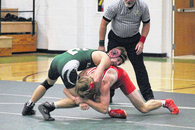 Eastern senior Dillon Aeiker defends a takedown attempt, during the Battle of the Birds on Dec. 19, 2018, in Tuppers Plains, Ohio.