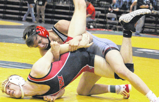 Point Pleasant senior George Smith locks in a hold on an opponent during a 132-pound match Thursday night at the 2019 WVSSAC Wrestling Championships being held at Big Sandy Superstore Arena in Huntington, W.Va.