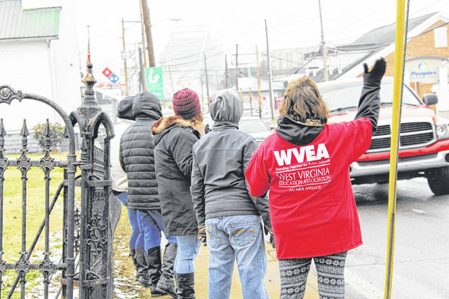 """Local educators in Mason County participate in a """"honk and wave"""" at the corner of 6th and Viand streets on Saturday in Point Pleasant, to raise awareness of Senate Bill 451, which deals with education reform. Those educators protesting the bill on Saturday said they were concerned about the funding of charter schools at the expense of public education and a vulnerable student population."""