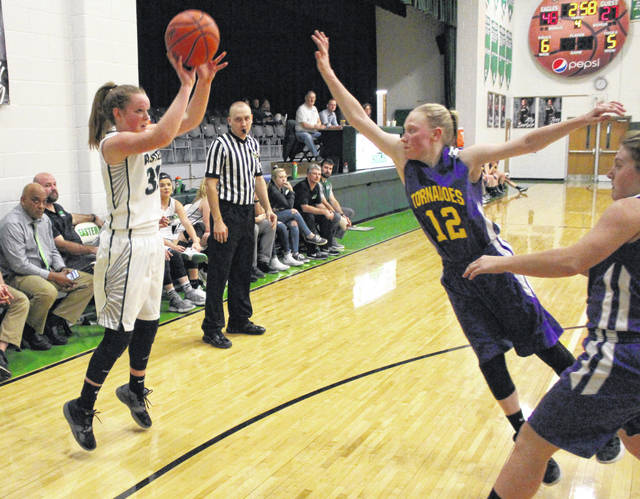 Eastern sophomore Sydney Sanders, left, releases a shot attempt over the outstretched arm of Southern defender Kayla Evans (12) during the second half of a Jan. 7 girls basketball contest in Tuppers Plains, Ohio.