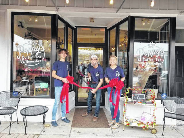 "Poppy's Coffee, Tea & Remedies at 46 Court Street in Gallipolis, officially opened for business on Jan. 2 with a ribbon cutting taking place on Jan. 19, which was also ""Poppy's"" birthday. Owner Greg Hall, pictured at center along with grandchildren McKenzie and Blake Skidmore, said he wanted to celebrate the ribbon cutting on his birthday so he would never forget it. Poppy's is described as a coffee shop complete with pastries, smoothie and juice bar and gift shop. Gallia Chamber of Commerce Board Members present for the ribbon cutting were Meagan Wood (Superior Marine Ways), Jenni Dovyak-Lewis (Area Agency on Aging, District 7), Amanda Ehman (Rio Grande Community College), Rick Jackson (The Wiseman Agency), Nick Dobbs (River Town Electric) and Chamber staff, Executive Director Elisha Orsbon, Associate Director Paige James. In addition, Poppy's delivers pastries and drinks in the downtown area. Call 740-446-9050 for more information."