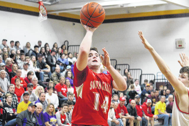 South Gallia senior Nick Hicks (14) releases a two-pointer, during the Rebels' 58-55 sectional final loss on Wednesday in Rocksprings, Ohio.