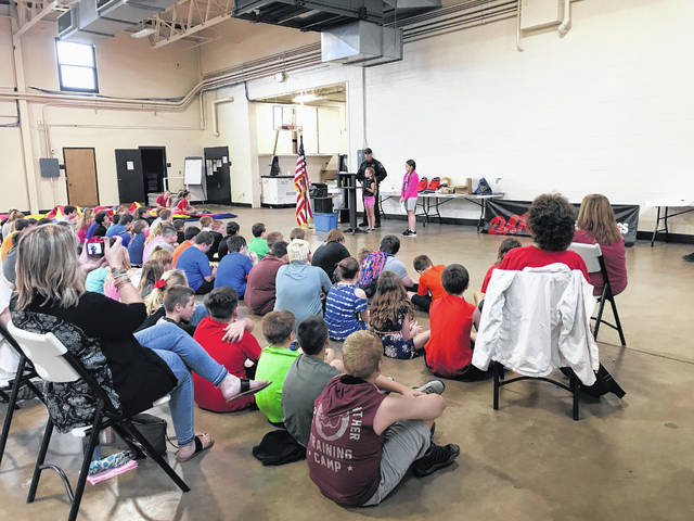 Each year, the fifth grade students who participate in the DARE program write essays on what they learned through the year. Pictured are essay winners from Beale Elementary last year, Delaney Pearson and Allizabeth Kauff, sharing their essays before their fellow DARE graduates and Lt. Troy Stewart.