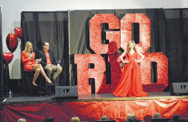 Model Nicole displays a red gown as part of the Women's Heart Celebration fashion show in Colony Club.