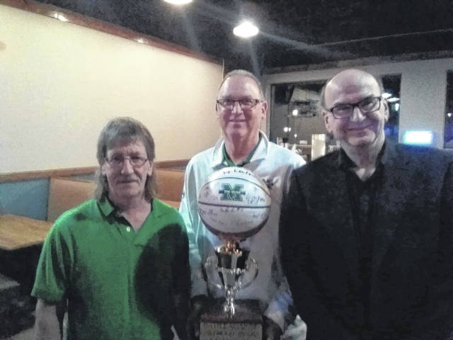 After the trophy's presentation to the Point Black basketball team, Dave Morgan took the trophy to Mashall University's Mason-Gallia-Meigs Big Green Chapter dinner. Pictured with Morgan are John Sutherland, executive director of the Big Green organization, and Mark Mitchell, board member of the Big Green Scholarship Foundation.