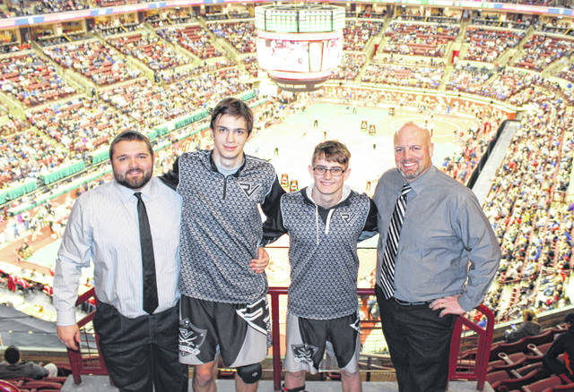 River Valley assistant coach Mark Allen, senior Eric Weber, freshman Nathan Cadle, and RVHS head coach Matthew Huck all pose for a picture in the top mezzanine during the 2019 OHSAA Division III Individual Wrestling Championships held Thursday at Ohio State University's Schottenstein Center in Columbus, Ohio.