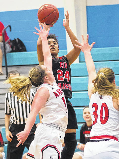 University of Rio Grande senior Jaida Carter (24) releases a shot attempt over a pair of defenders during a regular season contest.