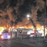 Near century-old building destroyed by fire
