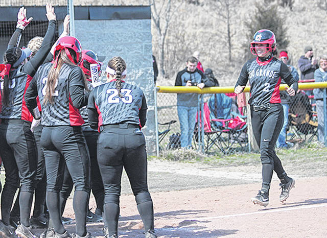 Rio Grande's Kenzie Cremeens (2) is greeted at home plate by her teammates after connecting on one of her two home runs in Saturday's game one win over Midway University at Rio Softball Park. The RedStorm swept the twinbill by scores of 8-0 and 14-2.