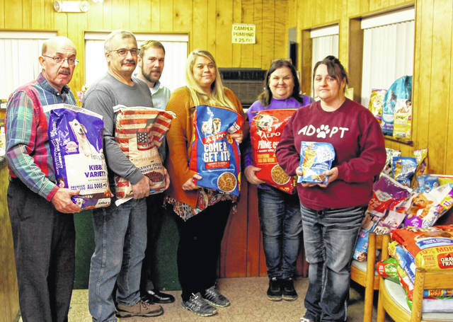 The Mason County Fair Board recently donated supplies to the Mason County Animal Shelter. Pictured, from left, are Fair Board Members Brian Billings, Shawn Paugh, Matt Roush and Nickki Hunt, Shelter employees Judy Oliver and Jessi Hall.