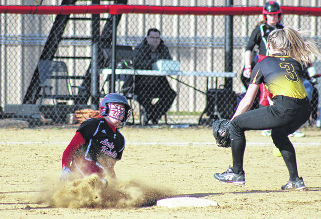 PPHS freshman Hayley Keefer (left) steals second base, during the Lady Knights' 15-1 victory on Tuesday in Point Pleasant, W.Va.