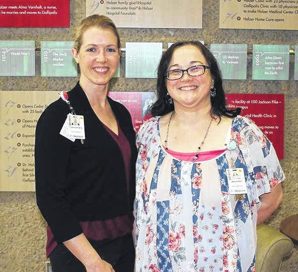 Pictured are Cassandra Hager, MSW, Care Management, left and Jennifer McKenzie, MSW, Care Management.