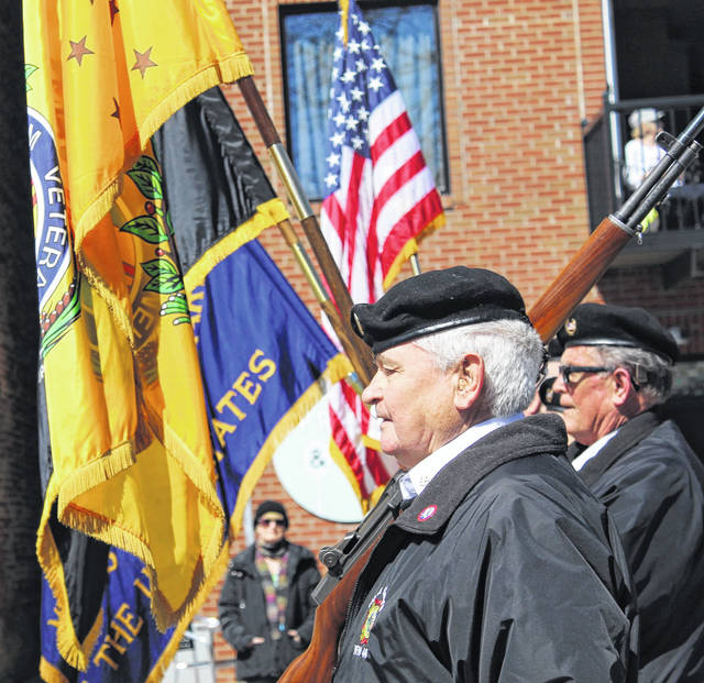 With the Gallipolis Police Department leading the way, the VFW Post #4464 Honor Guard carries the colors and begins the St. Patrick's Day Cultural Parade in Gallipolis.