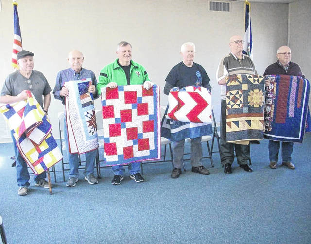 Pictured from left, John D. Meadows, Nick Nelson, Dennis Brumfield, Larry Hill, Charles Craft, John Bumgarner. Each veteran received a unique Quilt of Valor, made by members of the Quilts and Things Guild.