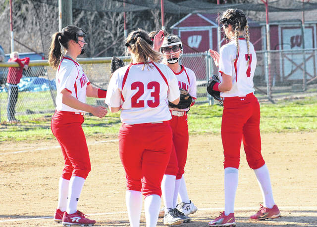 Members of the Wahama infield celebrate a strikeout with pitcher Hannah Billups (center), during her no-hitter on Wednesday in Hartford, W.Va.