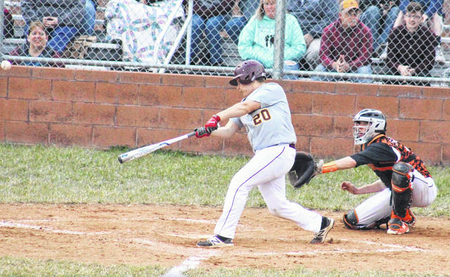 MHS junior Matt Gilkey (20) singles in the fifth inning of the Marauders' 8-0 victory over Belpre on Thursday in Rocksprings, Ohio.