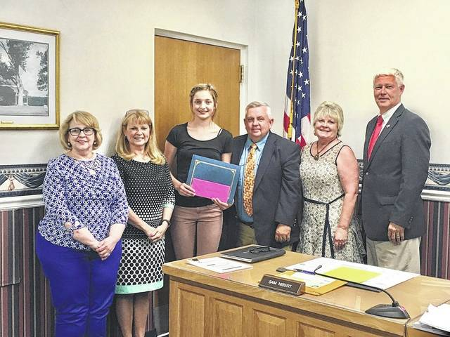 Emma Gibbs, third from left, a then-eighth grade student at Wahama Junior/Senior High School, was the county's first winner of the 2018 County Commissioner's Association (CCA) of West Virginia County Government Essay Contest. Others pictured during last year's presentation, from left, are Emma's West Virginia History teacher Catherine Hamm; CCA Executive Director Vivian Parsons; and Mason County Commissioners Sam Nibert, Tracy Doolittle, and Rick Handley.