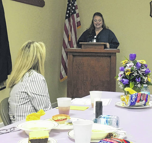 Amity Wamsley, nurse navigator for Holzer Cancer Care Center, speaks with Mason County Chamber of Commerce members regarding her position at the center as well as what the center offers their patients.