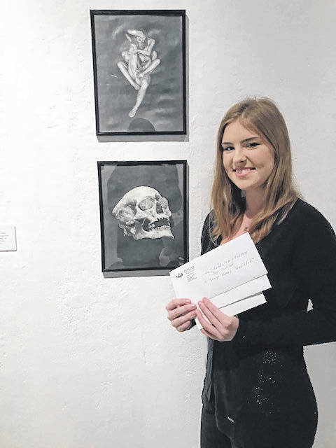 "Shalyn Greer, a candidate for the Bachelor's of Fine Arts at Ohio University in May in Athens, Ohio was a winner in this year's undergraduate juried art exhibition showcasing her graphite pieces ""Lust"" and ""Greed."" She received the Sina Sidwell Rodgers Prize in Fine Arts as well as the Excellence in Art Award from Lamborn's. Greer's work references biblical readings, utilizing dream-like imagery to create dark, surrealist pieces. Currently focusing on the seven deadly sins, Greer will complete five other graphite works to finish off the series for her 2019 Senior Thesis. She is the daughter of John Greer and Kristen Greer. She is a graduate of Wahama High School and was the art student of Susan Parrish."