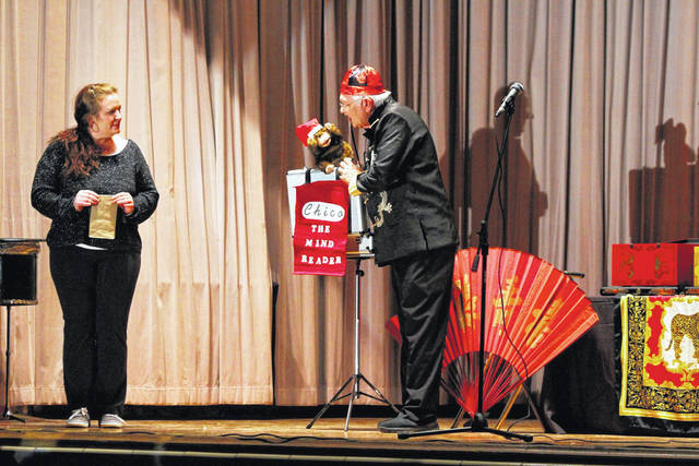 "Magician Dale Wheeler performing his act with his magical partner ""Chico the Mind Reader."""