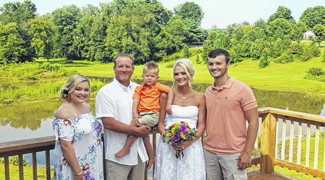 Pictured is the Nott family on Kevin and Nicole's wedding day, pictured along with Kevin and Nicole are Carly, Cameron, and Cain.