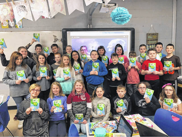 "One of three fifth grade classes is pictured at New Haven Elementary School after receiving their book, ""The BFG."" Books were purchased by the Accelerated Reading Committee, and distributed by Wahama High School student volunteer Allison Jewell."