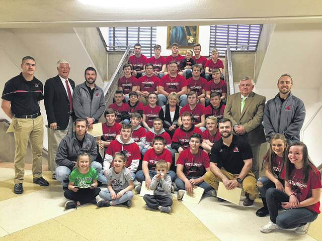 The Mason County Commissioners President Rick Handley, Sam Nibert, and Tracy Doolittle recently honored the Point Pleasant Big Blacks wrestling team along with their Head Coach John Bonecutter, the team's assistant coaches, and the team's support staff for the team's achievements at the WVSSAC (West Virginia Secondary School Activities Commission) Wrestling Championships.