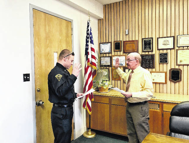 Officer John Patterson being sworn in to the Point Pleasant Police Department by Mayor Brian Billings.