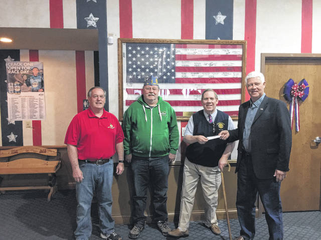 The American Legion Post 23 and the Sons of the American Legion recently donated to the Gold Star Mothers Monument. Those pictured, from left, are Committee Member Ed Cromley, Adjutant of the Sons of the American Legion David Nibert, Commander of Post 23 Miles Epling, and Mason County Commission President Rick Handley.