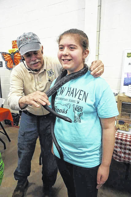 "The ""Snakes of West Virginia"" exhibit by Roy Moose was a popular booth at last year's Mason County Outdoor Youth Expo. Those students who were brave enough were treated to a snake necklace for a short time."