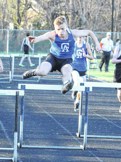 Gallia Academy junior Ian Hill clears an obstacle during the 300m hurdles event at the 2019 Gallia County Meet held at River Valley High School on April 9 in Bidwell, Ohio.