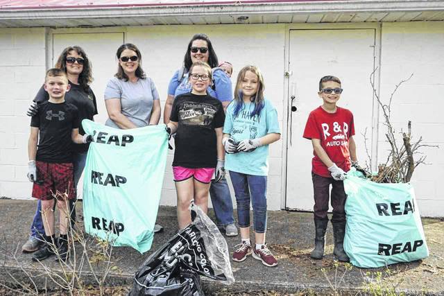 "Some of the students from the fourth grade classes at New Haven Elementary School, along with their teachers and a volunteer, are pictured during a cleanup at the town park as part of the ""West Virginia Make It Shine"" statewide cleanup initiative."