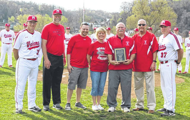 Prior to Wahama's varsity baseball game against Waterford at Claflin Stadium last week, the White Falcons honored former coach Tom Cullen for 38 years with the program, including 14 as head coach. Cullen threw out the first pitch, and was presented a plaque. Pictured from left are, Wahama head coach Billy Zuspan, Wahama Athletic Director Ron Bradley, Garrett Cullen, Laura Cullen, Tom Cullen, WHS Principal Kenny Bond, Wahama assistant coach Wes Bumgarner.