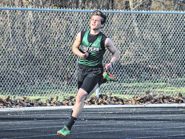 Eastern junior Michael Letson runs the third leg of the 4x200m relay at the River Valley Open on April 2 in Bidwell, Ohio.