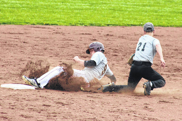 Meigs sophomore Wyatt Hoover (9) successfully steals second base behind a tag attempt from RVHS senior Andrew Mershon (21), during the Marauders' 4-1 win on Wednesday in Rocksprings, Ohio.