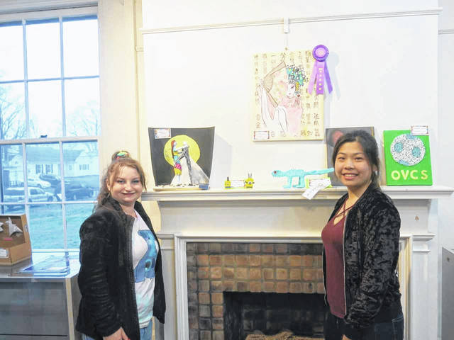 Pictured are Marcie Kessinger and Joicy Liao during the opening reception for the Ohio Valley Christian School Art Show, currently hosted by the French Art Colony.