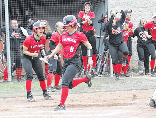 Rio Grande's Cammy Hesson (8) scores the winning run in Friday's 4-3, nine-inning game two win over Indiana University Southeast at Rio Softball Park.