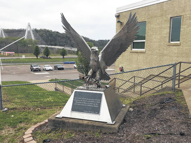 Pictured is the White Falcon statue that sits outside the entrance to Wahama High School, with the Medal of Honor Bridge pictured in the background. The White Falcons won't be crossing the Medal of Honor Bridge as much in the future after agreeing to leave the TVC Hocking and join the Little Kanawha Conference at the start of the 2020-21 school year.