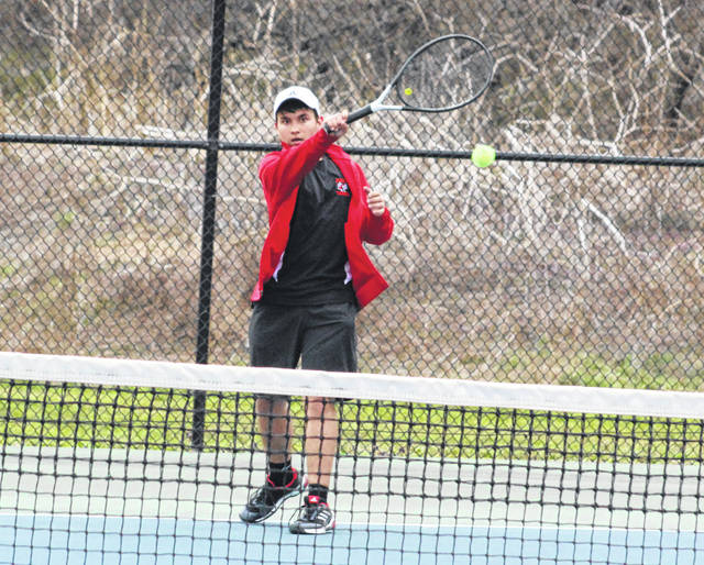 Point Pleasant junior Carson Chambers hits a forehand return during a March 29 match against Sissonville at The Courts in Point Pleasant, W.Va.