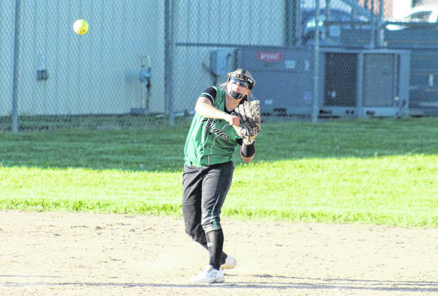 Eastern senior Mollie Maxon throws to first base, during the Lady Eagles' 10-9 setback on Monday in Tuppers Plains, Ohio.
