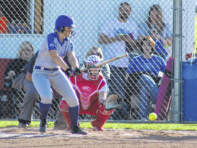 Gallia Academy senior Aubrey Unroe drops a swinging bunt down during the sixth inning of Monday night's OVC softball contest against Rock Hill in Centenary, Ohio.