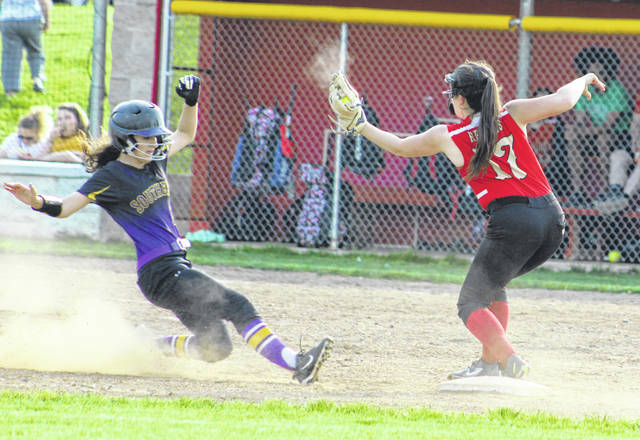 Southern junior Valerie Ritchart, left, slides safely into second base ahead of a tag by South Gallia's Lalla Hurlow during Tuesday night's TVC Hocking softball contest in Mercerville, Ohio.