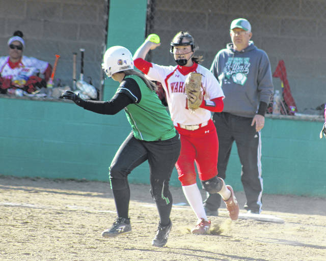 Wahama freshman Lauren Noble chases after an Eastern player during a run-down in the fourth inning of Tuesday night's TVC Hocking softball contest in Tuppers Plains, Ohio.