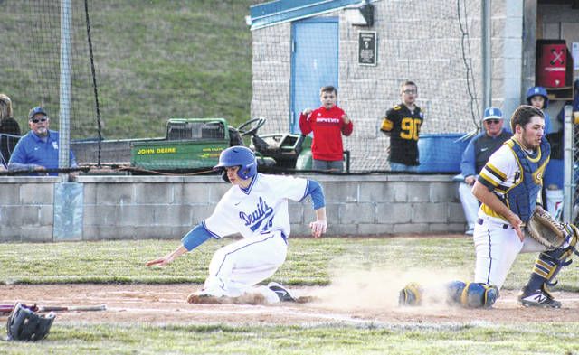 GAHS sophomore Adam Stout slides in for the go-ahead run, during the Blue Devils' 2-0 victory over South Point on Wednesday in Centenary, Ohio.