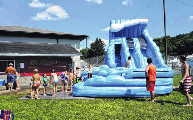 As a special feature on last year's opening day of the New Haven Municipal Swimming Pool, an 18-foot water slide was rented. The town is currently in the midst of a fundraising campaign to provide free admission to the pool for the upcoming summer season.